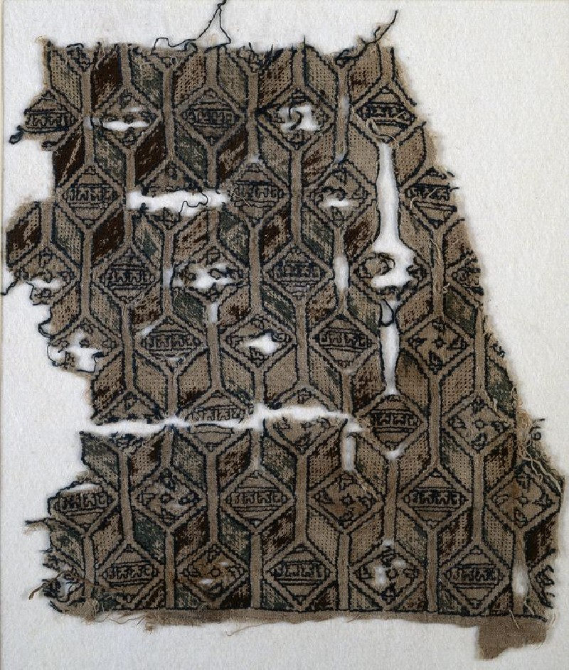 Textile fragment with linked diamond-shapes, hexagons, and pseudo-inscription (front            )