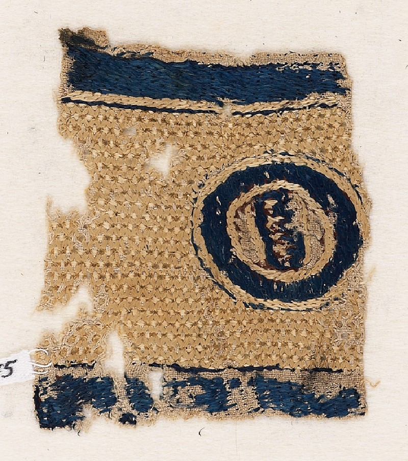 Textile fragment with circle and pseudo-inscription (EA1984.275, front            )
