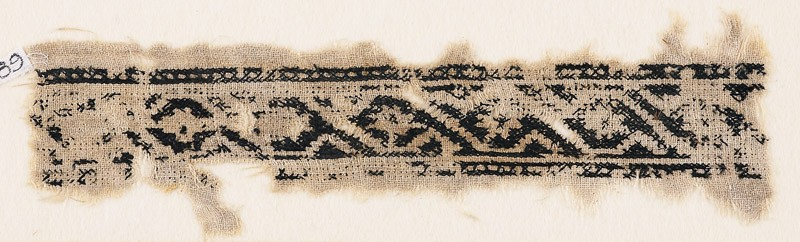 Textile fragment with linked scroll and rosettes