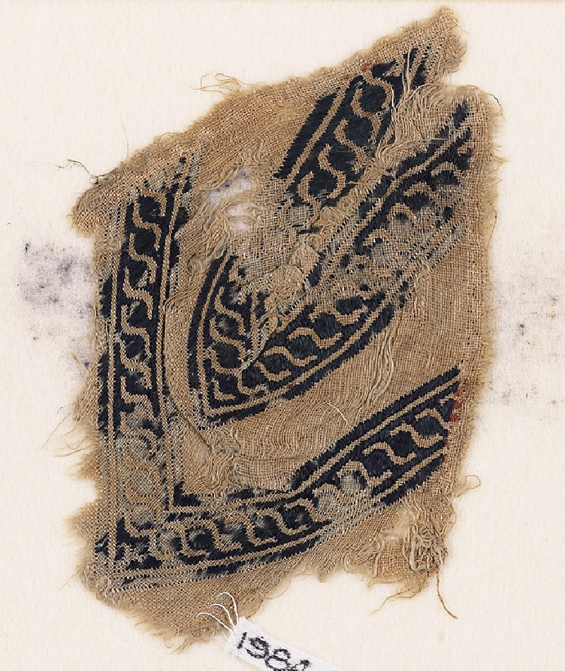 Textile fragment with linked scrolls of S-shapes, possibly from a garment (EA1984.290, front            )