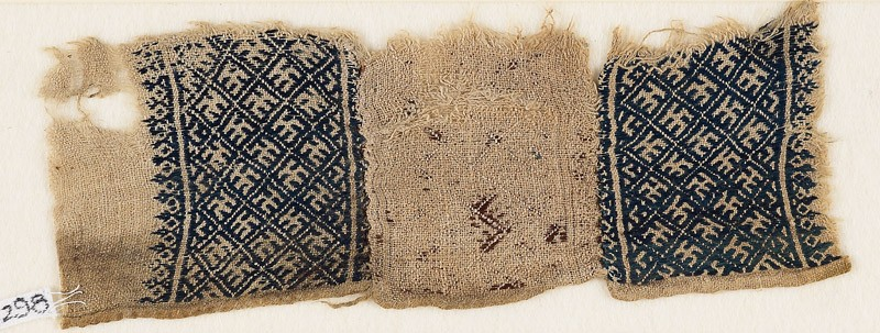 Textile fragment with grid and stylized letter (EA1984.298, front            )