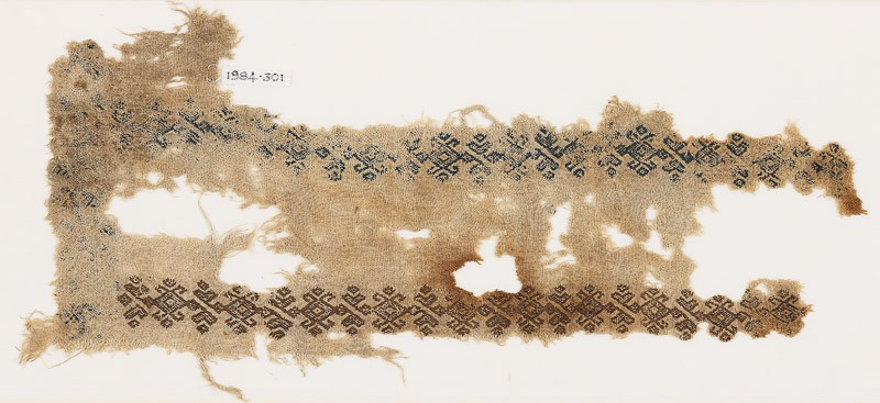 Textile fragment with linked hooks and stylized leaves (EA1984.301, front            )
