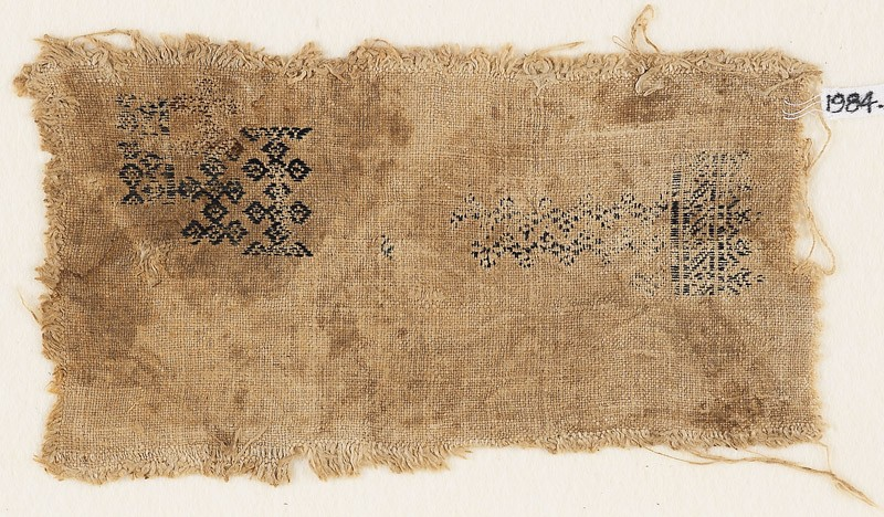 Textile fragment with linked quatrefoils and chevrons (EA1984.302, front            )