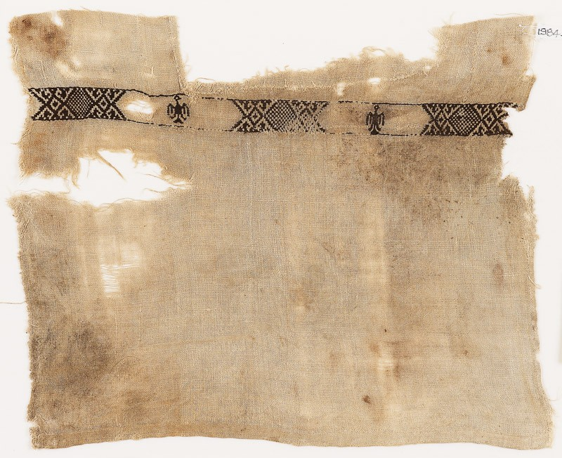 Textile fragment with hexagons and eagles