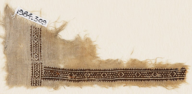 Textile fragment with diamond-shapes and a rope