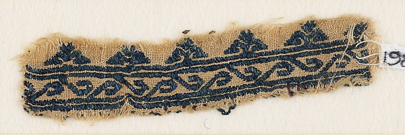 Textile fragment with scroll and floral trefoils