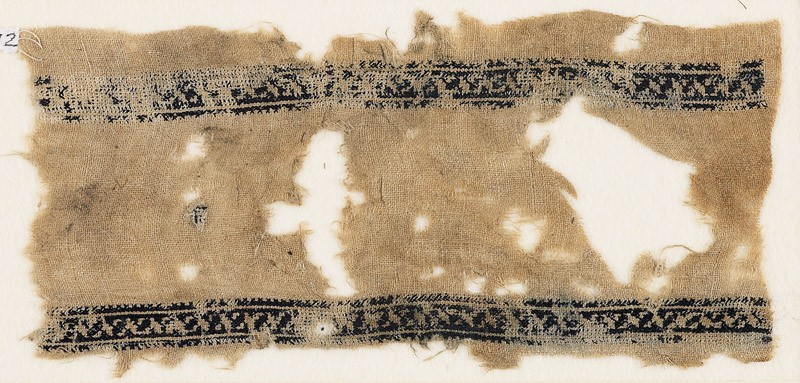 Textile fragment with bands of stylized leaves