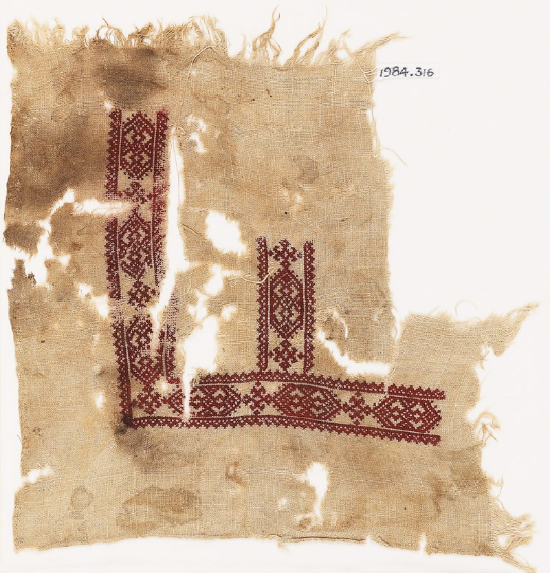 Textile fragment with cartouches and hooks (front            )