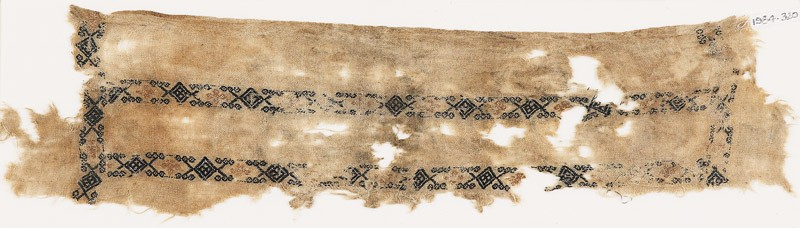 Textile fragment with bands of diamond-shapes, hexagonal cartouches, and quatrefoils