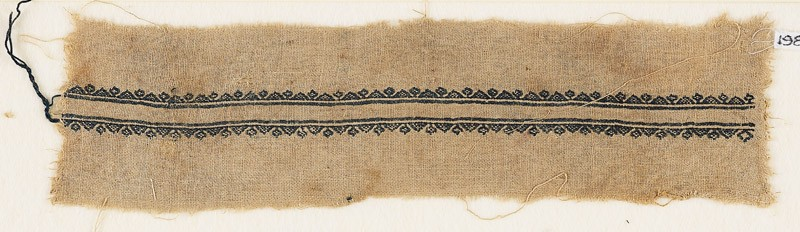 Textile fragment with triangles and stylized flowers (EA1984.321, front            )