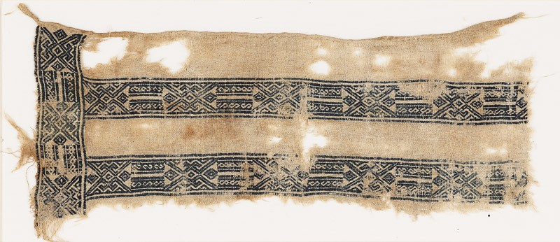 Textile fragment with linked hexagons, squares, and S-shapes (EA1984.322, front            )