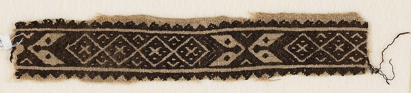 Textile fragment with band of linked-diamonds and cartouches (EA1984.326, front            )