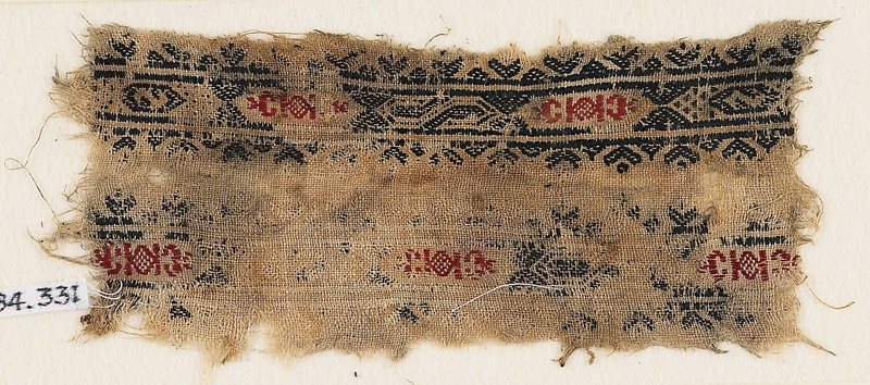 Textile fragment with bands of hexagonal cartouches, S-shapes, diamond-shapes, and crescents