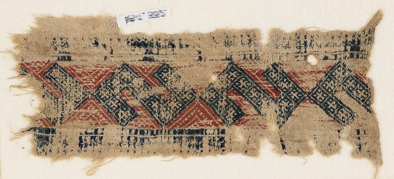 Textile fragment with linked S-shapes and crosses