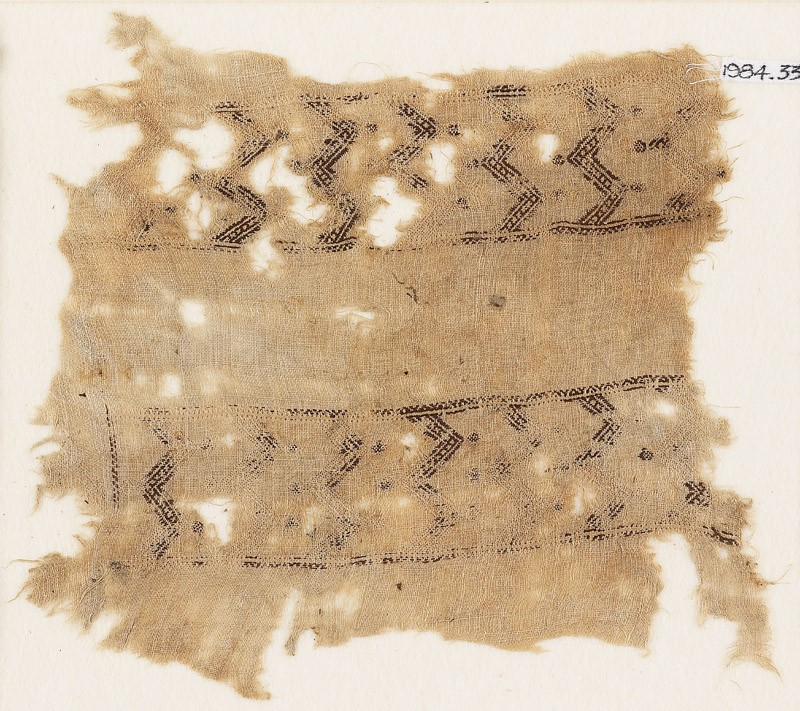 Textile fragment with bands of double chevrons and flowers (front            )