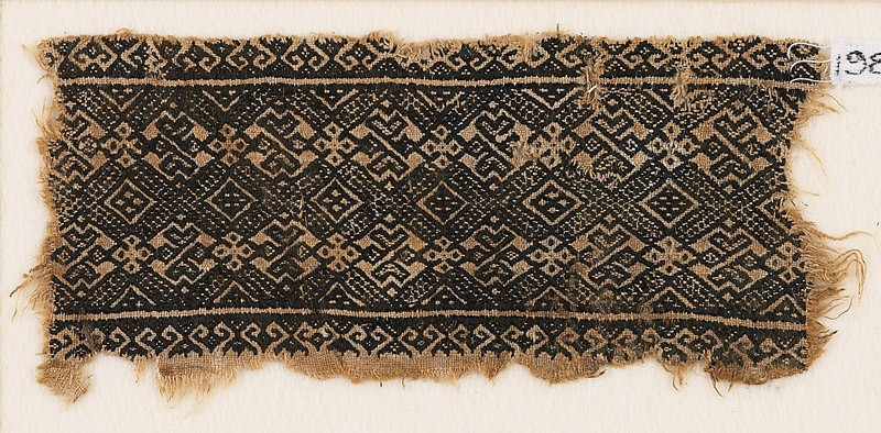 Textile fragment with linked diamond-shapes, rosettes, and possibly palmettes