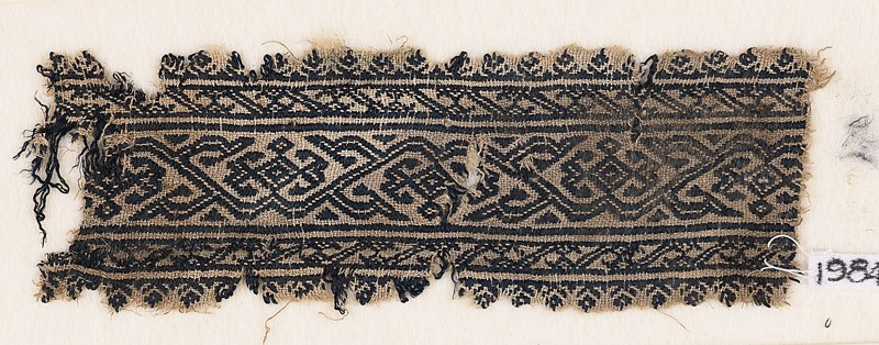 Textile fragment with vine and diamond-shaped flowers