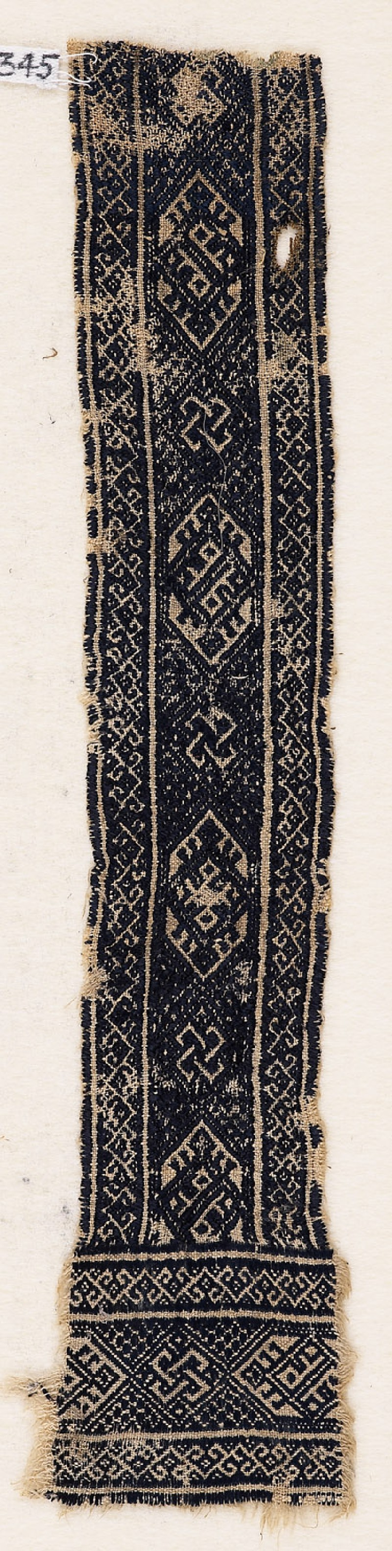 Textile fragment with interlacing knots, cartouches, diamond-shapes, and hooks