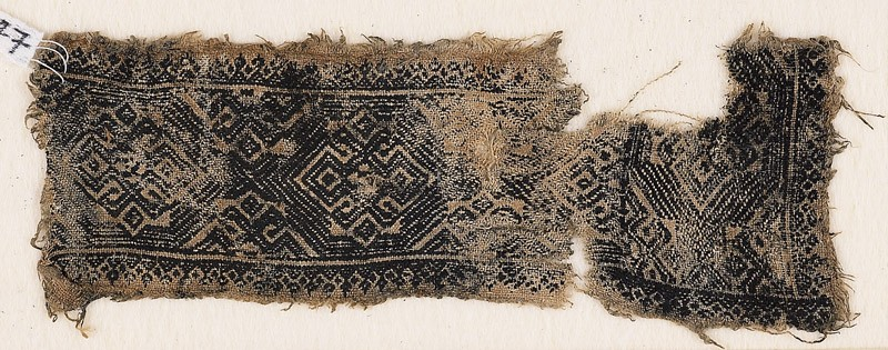 Textile fragment with bands of ornate diamond-shapes and hooks (EA1984.347, front            )