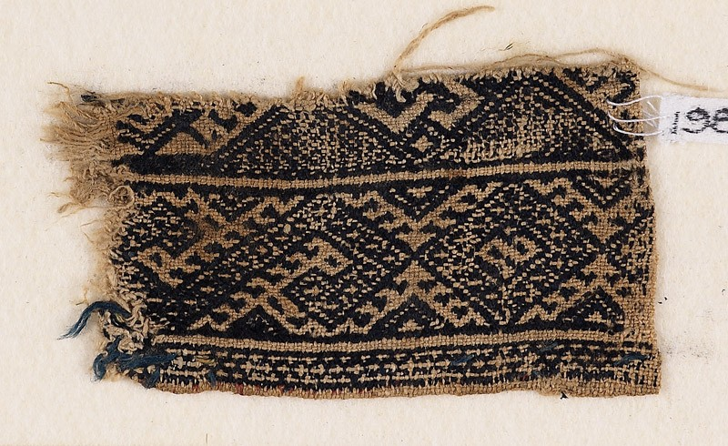 Textile fragment with bands of diamond-shapes and S-shapes