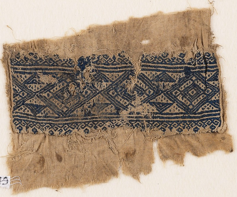 Textile fragment with linked diamond-shapes, triangles, and flowers