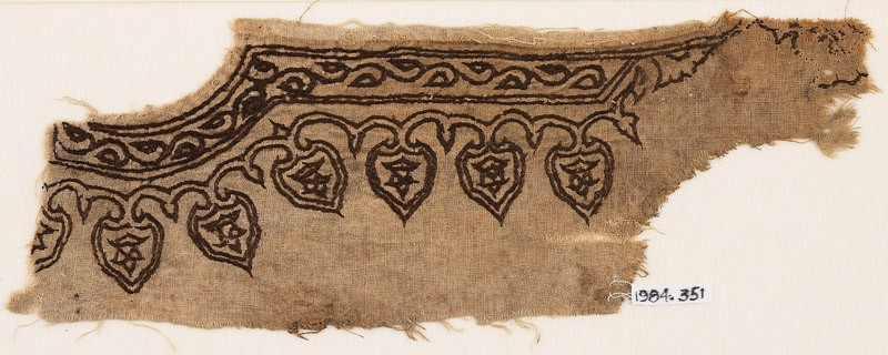 Textile fragment from the neck of a garment with vines and leaves