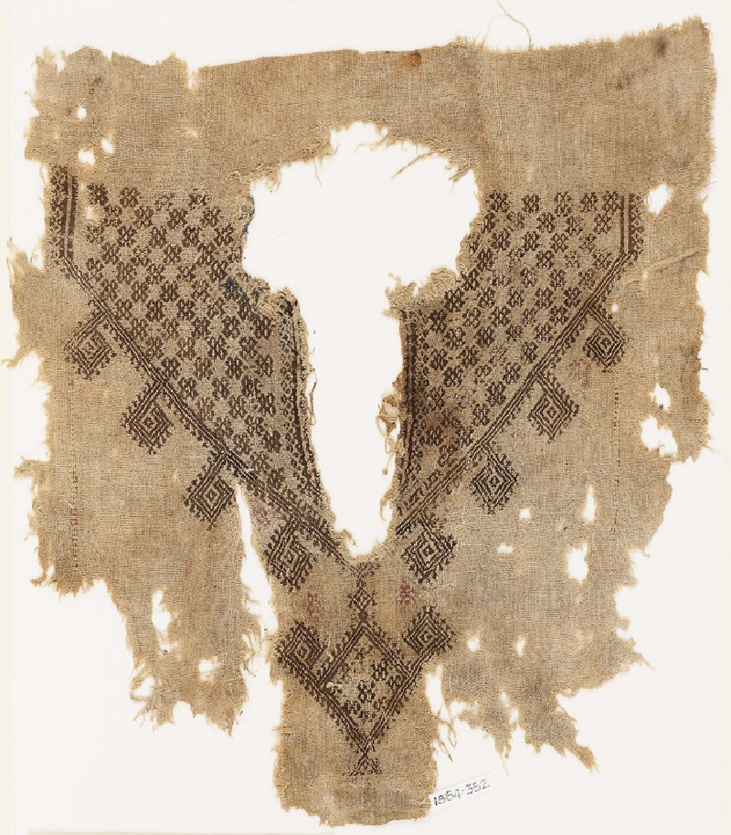 Fragment from the neck opening of a tunic with crosses and diamond-shapes (front            )