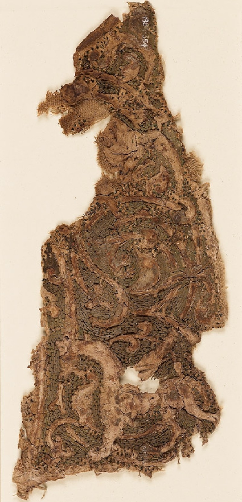 Textile fragment with interlacing vines and an animal, probably a griffin