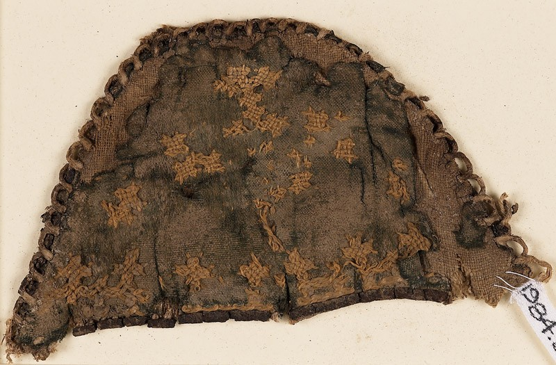 Textile fragment from a slipper front with linked crosses (EA1984.360, front            )