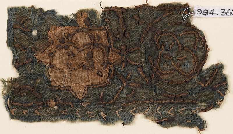 Textile fragment with star and interlocking circles (EA1984.362, front            )