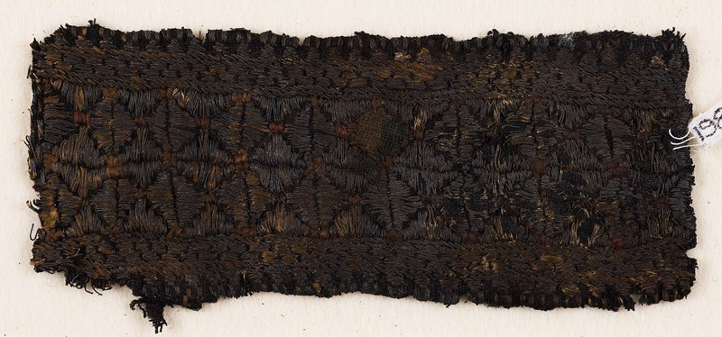 Textile fragment with band of stars or flowers (front            )