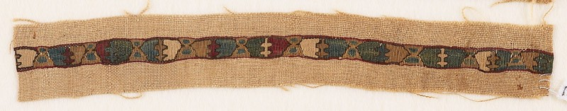 Textile fragment with chalices and crosses, possibly from a vestment