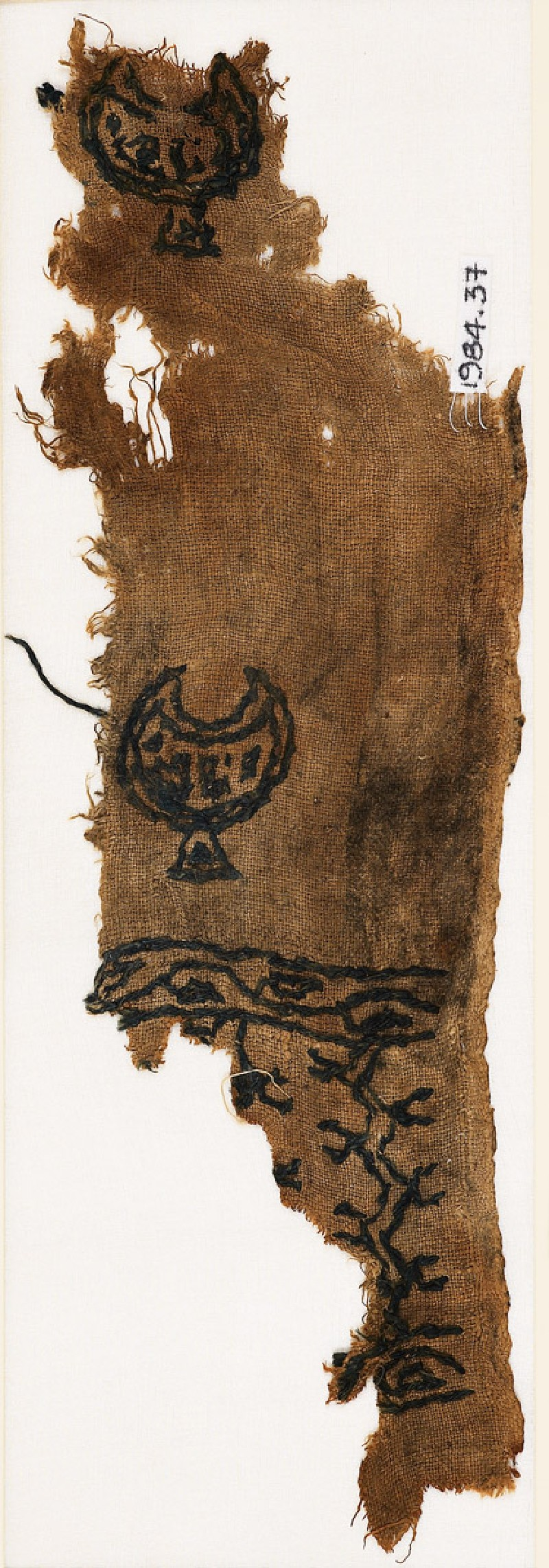Textile fragment with crescents or cups, chevrons, and vine