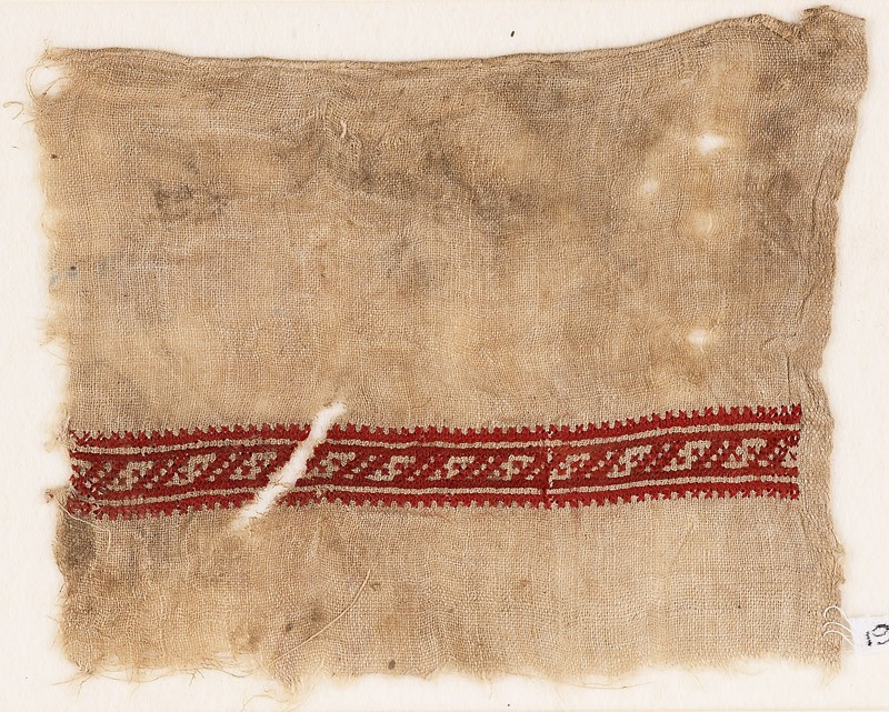 Textile fragment with band of S-shapes (front            )