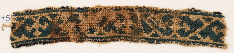 Textile fragment with band of vines and trefoils (front            )