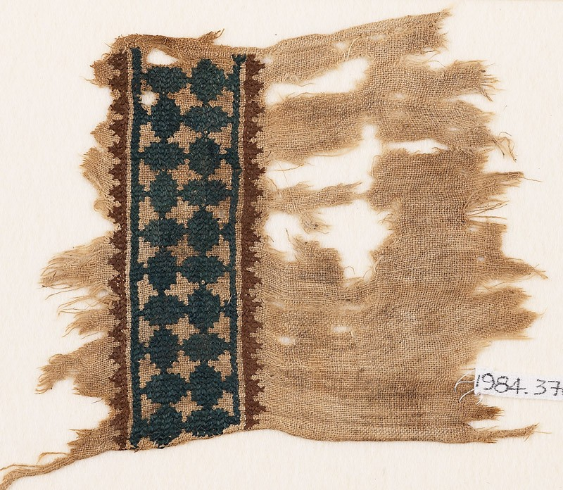 Textile fragment with band of linked ovals and zigzag border (EA1984.376, front            )