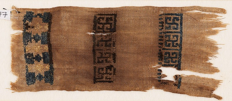 Textile fragment with swastikas and stars