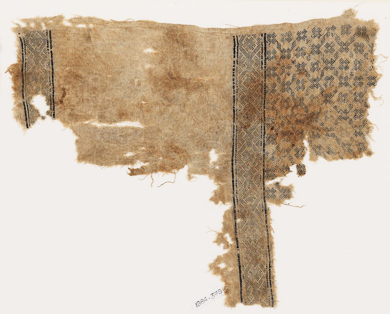 Textile fragment with flowers, crosses, and interlacing diamond-shapes