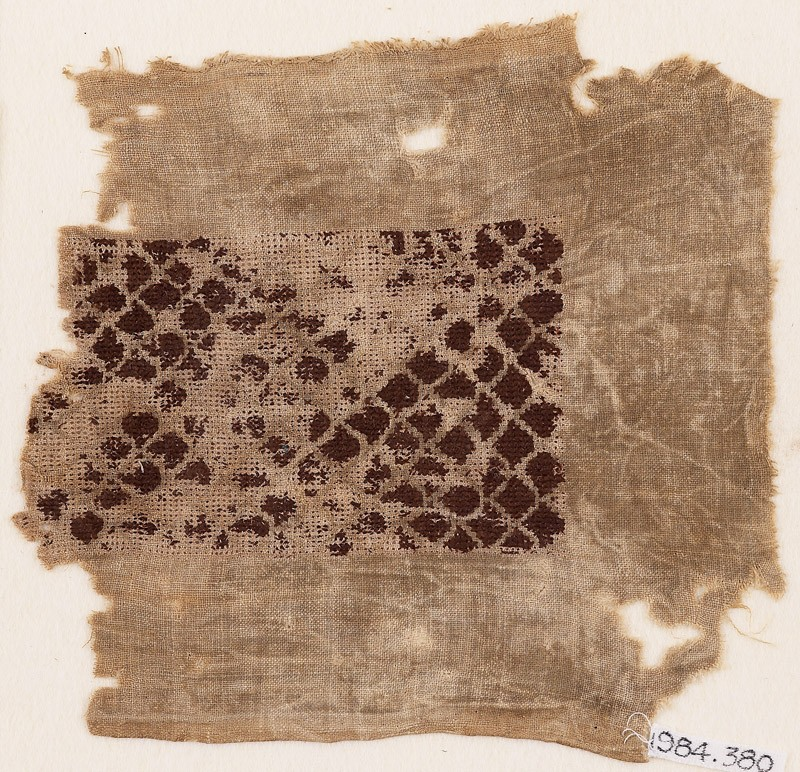 Textile fragment with scalloped pattern
