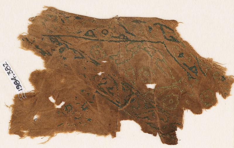 Textile fragment with vines and leaves, probably from a garment or trousers
