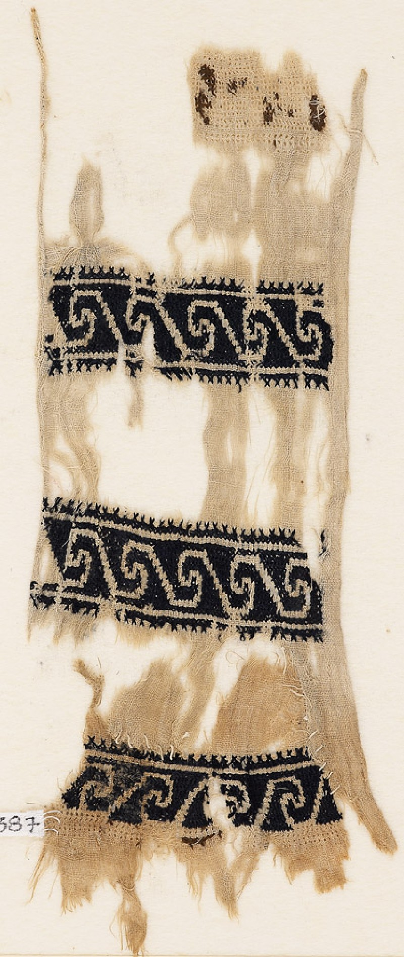 Textile fragment with scrolls (EA1984.387, front            )