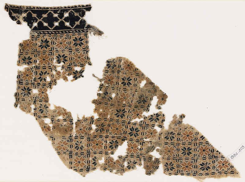 Textile fragment with eight-pointed stars or flowers (EA1984.403, front            )