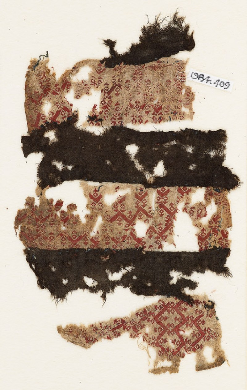 Textile fragment with three bands of chevrons