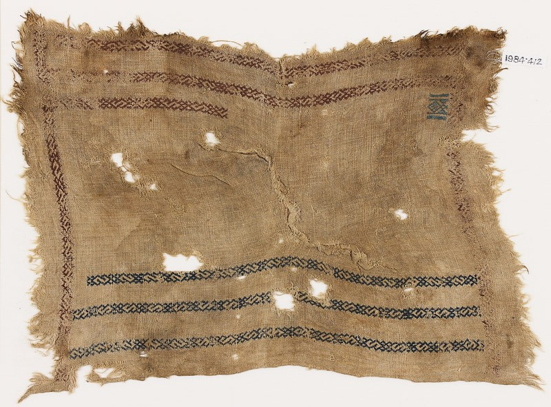 Cloth with S-shapes linked with small crosses