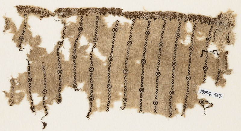 Textile fragment with reversed S-shapes, possibly from a tunic (EA1984.417, front            )