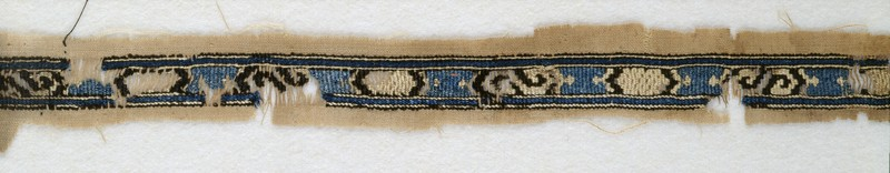 Textile fragment with band of cartouches and S-shapes