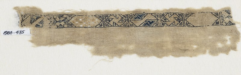 Textile fragment with band of cartouches, spirals, and stars (front            )