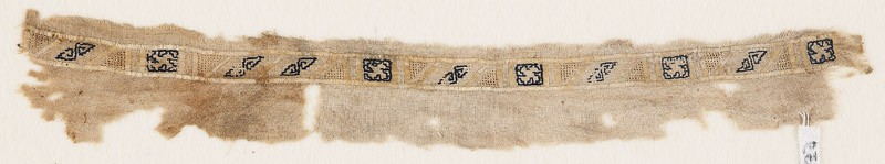Textile fragment with alternating rectangles and squares