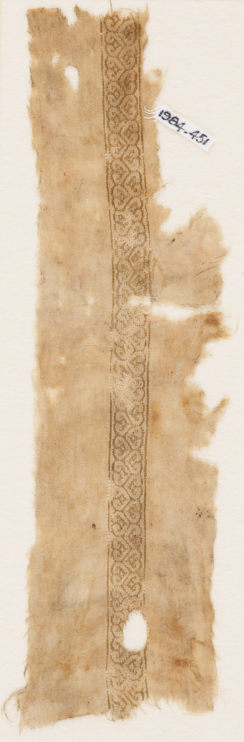 Textile fragment with band of linked hearts