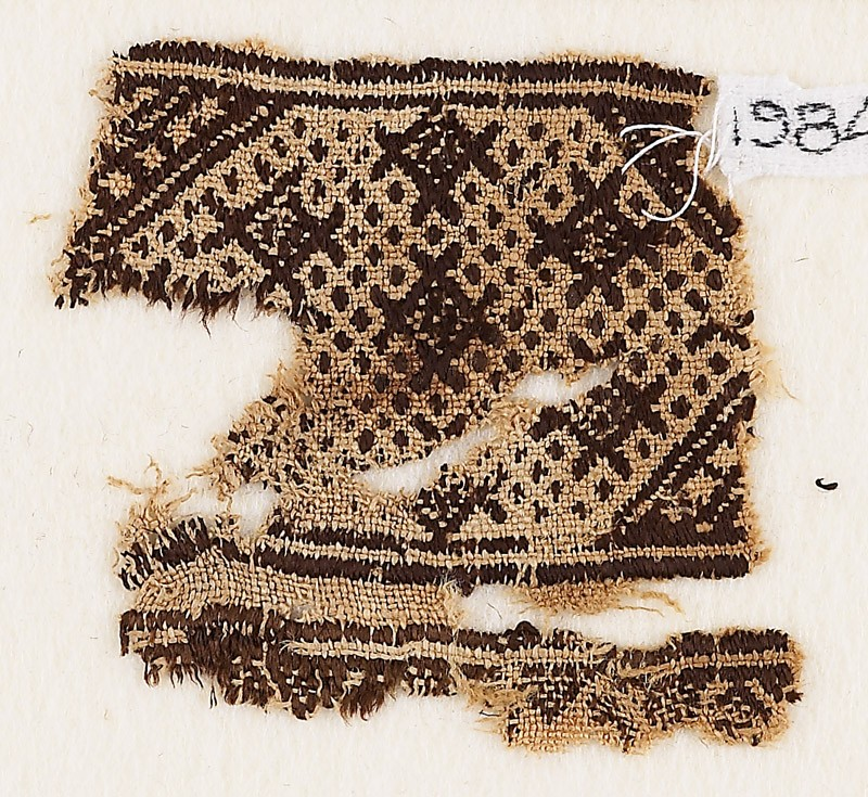 Textile fragment with diamond-shapes against a background of dots (EA1984.457, front            )